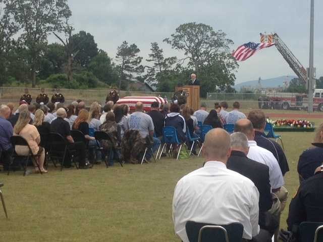Hundreds of people attended a memorial service for 41-year-old Scott County Sheriff Cody Carpenter at Waldron High School's football field.