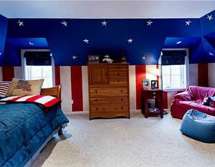 "This spacious, double-window ""stars-and-stripes"" themed space is perfect for a guest or childs bedroom."