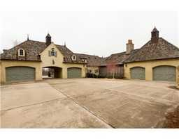 Four garages accompany this 4.78 acre lot and 10,942 square foot Jack Arnold custom-designed home.