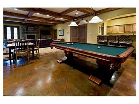 This game and living area with exposed beam ceilings and a bonus kitchen will ensure everybody a good time.