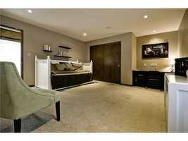 This large, open space is a perfect spare room with a large double-door closet and natural light.