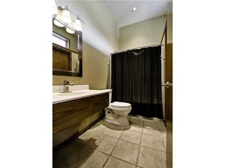 Check out this sleek full bath. It is 1 of 7 bathrooms in this 8,700 square foot home!