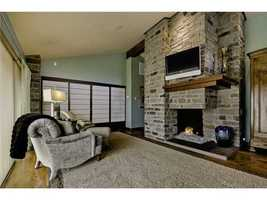 Another look at the master suite sitting area... check out that extravagant fireplace!