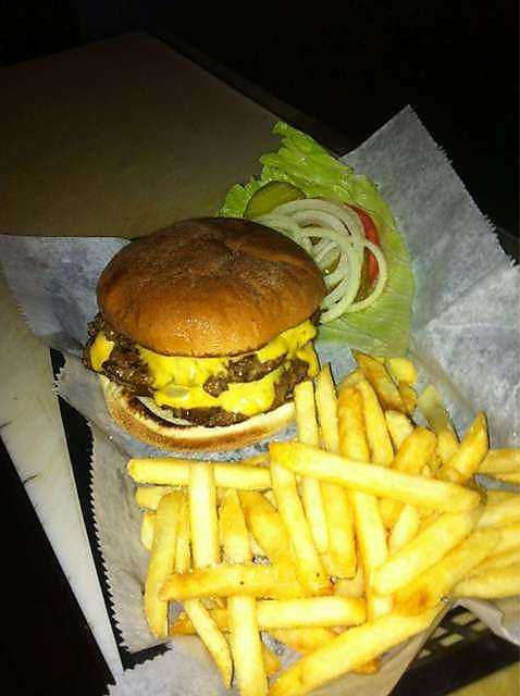 Art's Place is located in Fayetteville off North College Avenue. Pictured is the double cheeseburger served on toasted bun and is available year round.