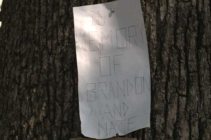 Family and friends set up a memorial for homicide victims Nathan Young and Brandon Prince