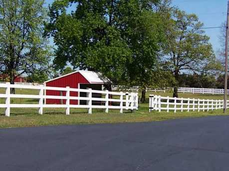 The house sits on 10.5 acres with fenced land and a feed shed for conveniently caring for animals.