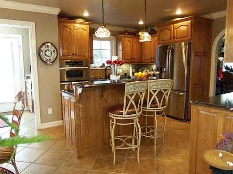 The kitchen, complete with modern appliances, still maintains a simple country feel. The breakfast nook just off to the side is the perfect place to enjoy a country breakfast.