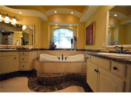 It has his and her sinks and walk-in closets.