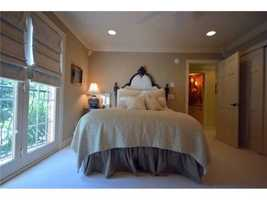This bedroom has doors to let in fresh air.