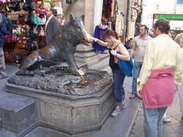 """Visitors touch this copy of """"Il porcellino"""" in Florence for good luck."""