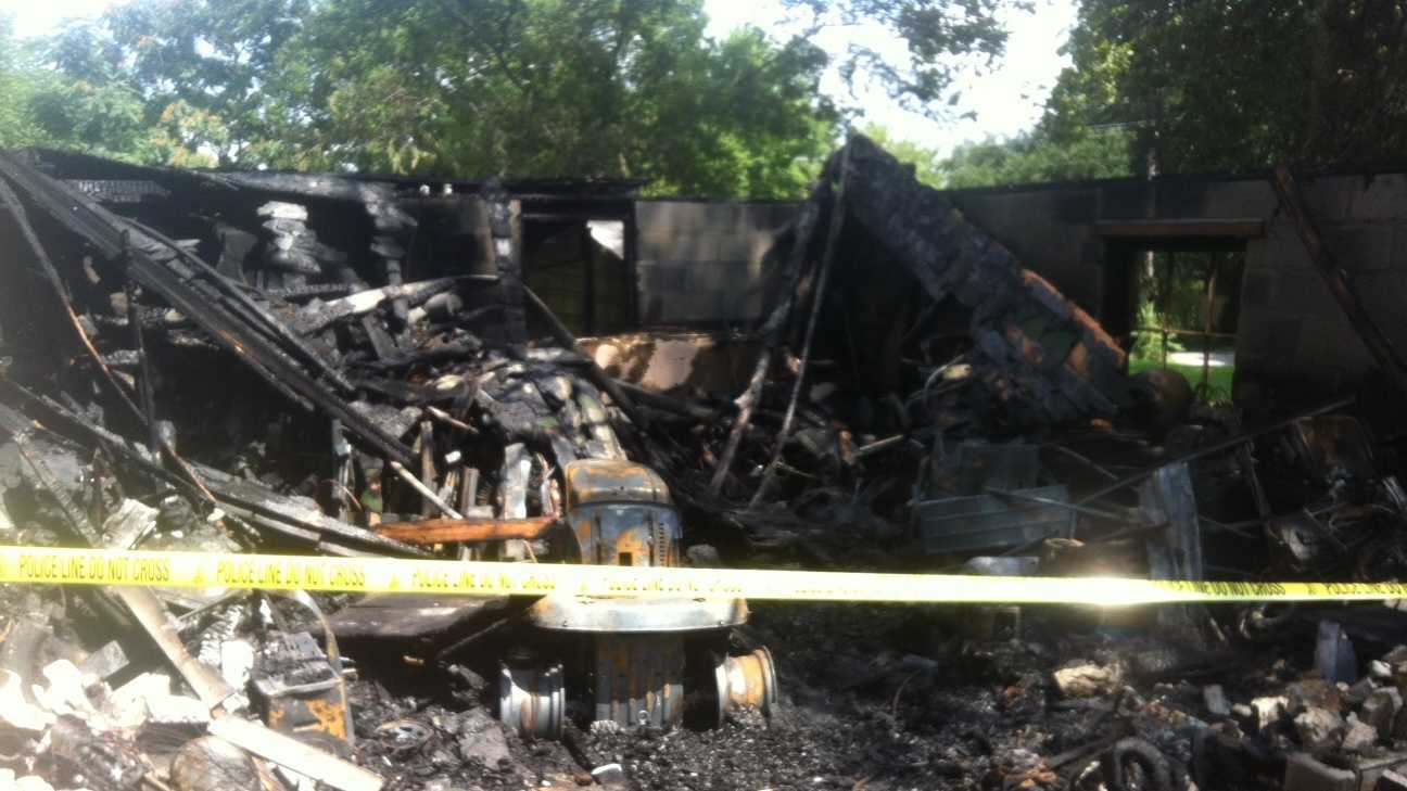 Fire destroys garage near homes
