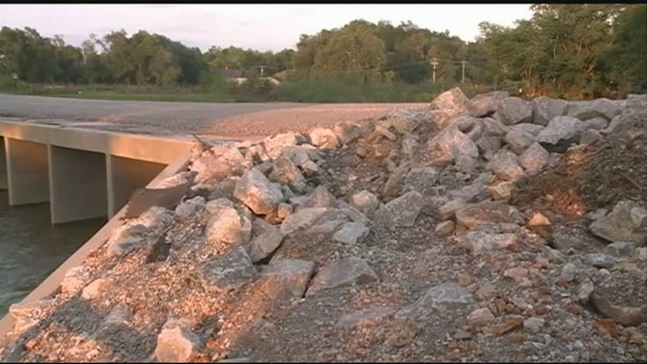Springdale will  have to repair a new bridge damaged by last week's flood.