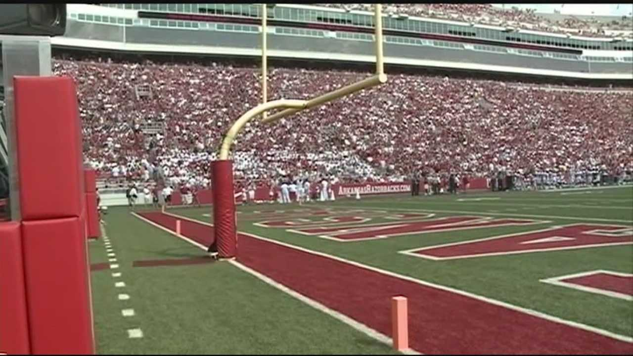 The University of Arkansas says it is investigating what caused a t-shirt cannon to explode at Saturday's game.
