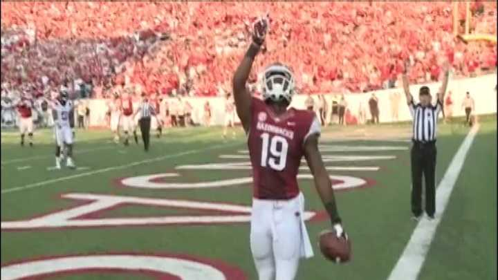 Wide receiver Javontee Herndon points skyward after a touchdown catch in the first quarter, his third of the season.
