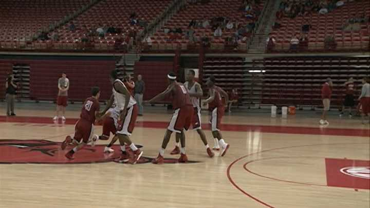 Kikko Haydar chases Dee Wagner through a screen during an open team practice for the Razorback men's basketball team at Bud Walton Arena.