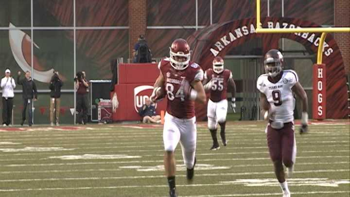 Hunter Henry catches a pass for a big gain against Texas A&M at Razorback Stadium.