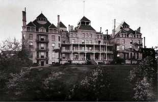 "Built in 1886, the Crescent Hotel in Eureka Springs has a reputation as ""America's Most Haunted Hotel.""  At least 8 ghosts roam the hallways."