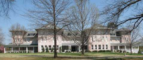 Many visitors have reported ghosts floating through the Inn at Carnall Hall at the University of Arkansas.