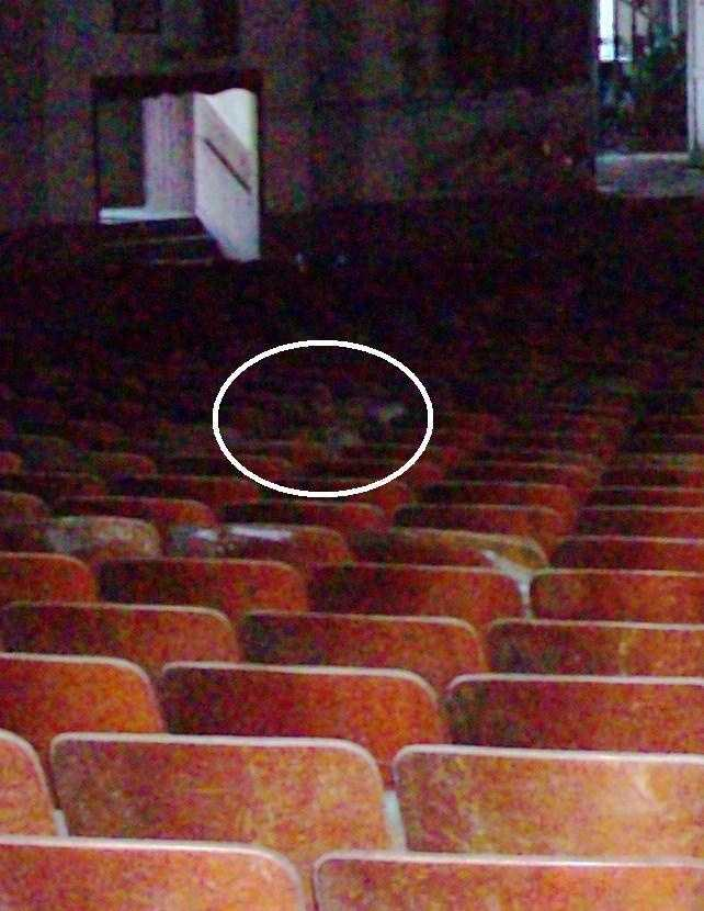 Does this photo show a ghost in the audience at the old theater in Barling?