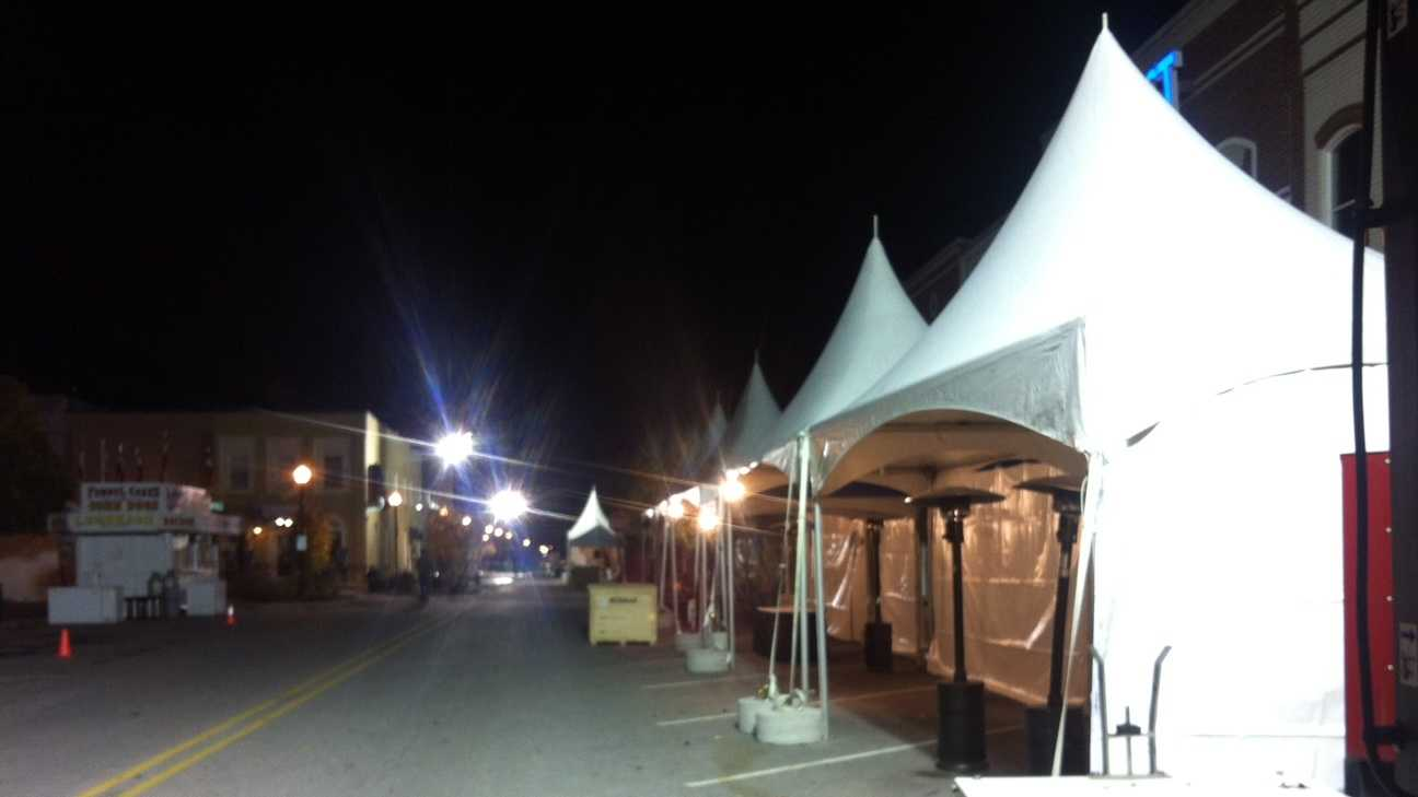 Crews get tents ready for First Fridays