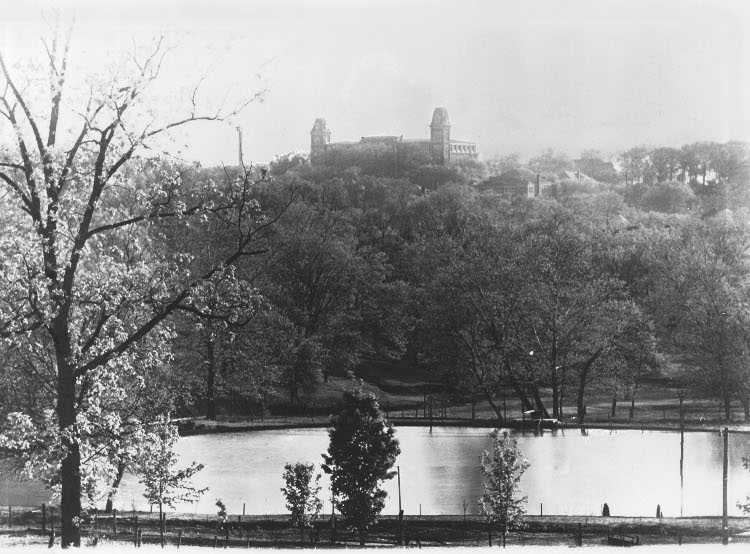 Old Main in the 1920's, as seen from Trent's Pond. (now Wilson Park)