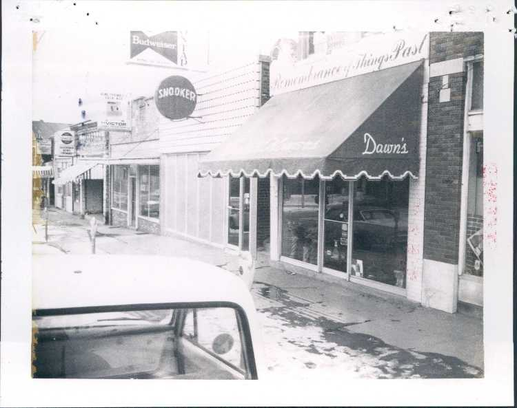 Shops on the block of 400 W. Dickson in 1973.