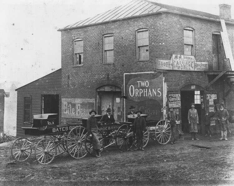 A 1889 photo of the W.H. Jordan Wagon & Carriage Works, in the current location of the courthouse.