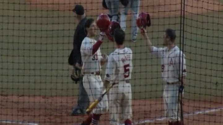 Arkansas' Krisjon Wilkerson celebrates at home plate after a home run.