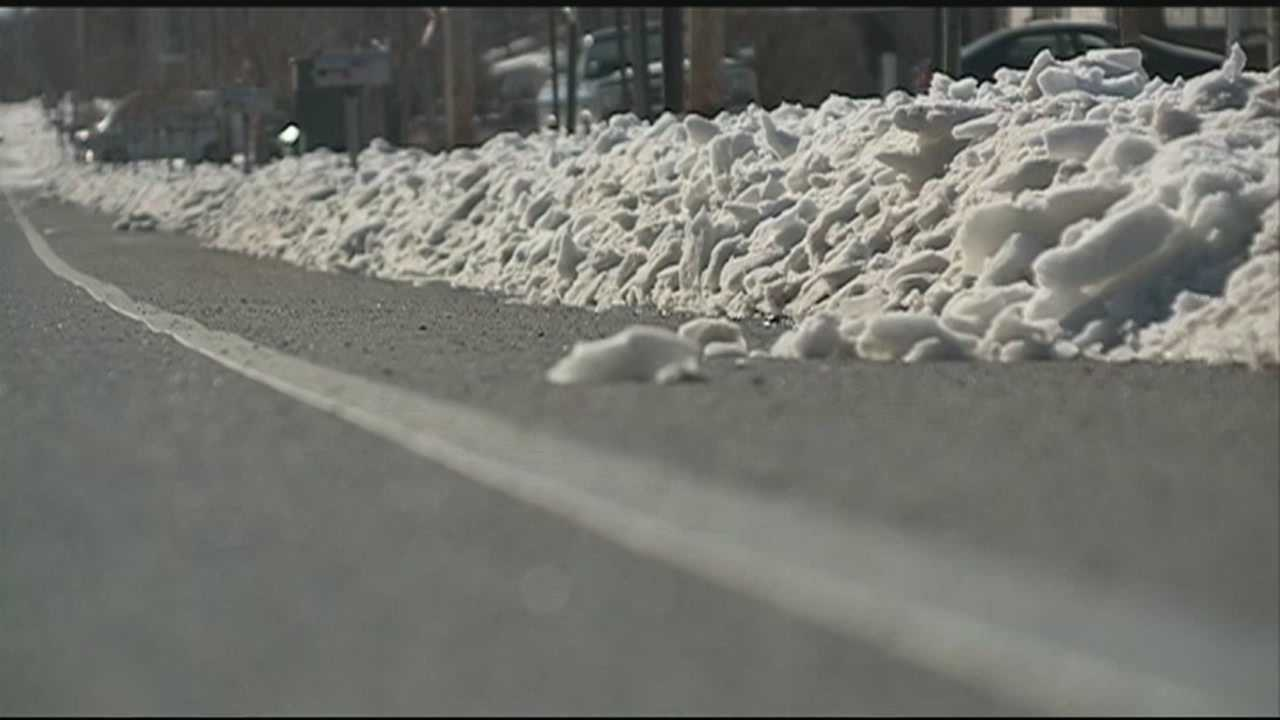 Some drivers say they're having a tough time getting over the piles of snow left behind by snow plows.