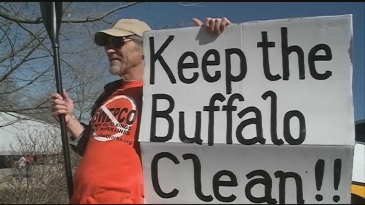People protested outside of the Governor's Conference on Tourism in Oct. 2014, asking Governor Beebe to protect the Buffalo River from a nearby hog farm.