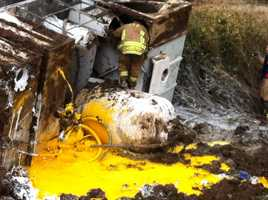 Paint spilled in rollover accident on Huntsville Road