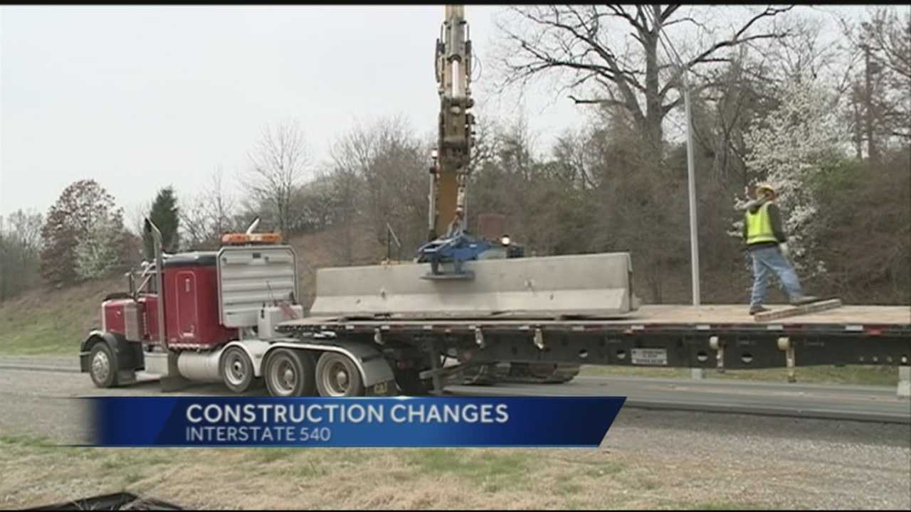 Construction crews remove wall barriers on interstate 540