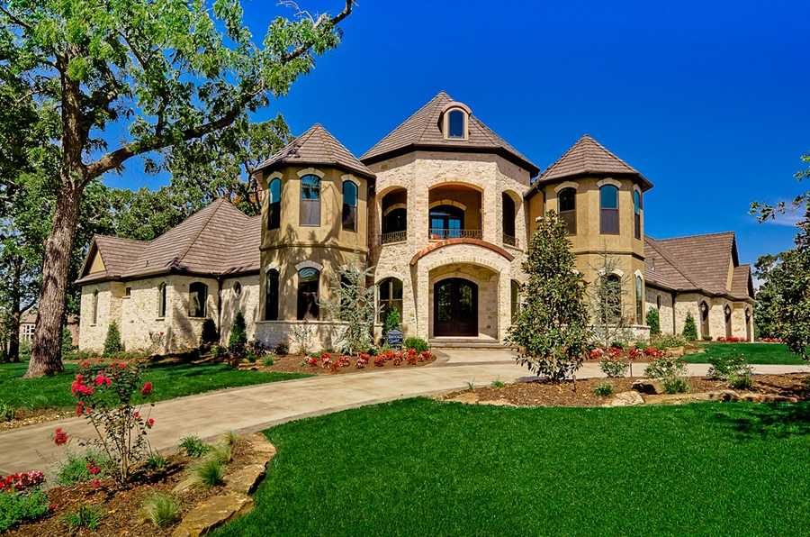 This Tuscan inspired home is located at 1 Dover Drive in Rogers. Take a look at the pristine landscape.