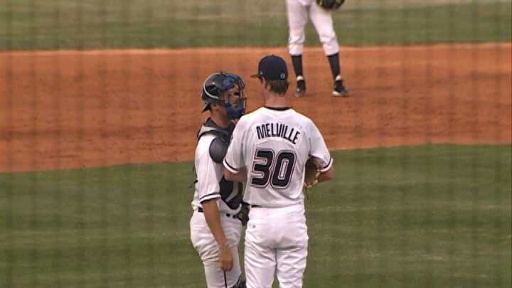 Northwest Arkansas Naturals Pitcher Tim Melville confers on the mound with catcher Parker Morin at Arvest Ballpark