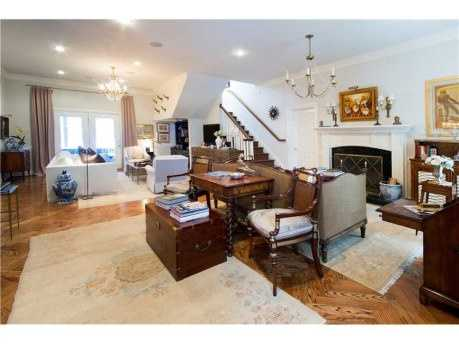 Over $100,000 worth of updates including a heated pool, landscaping, security system and smart home automation. Master suite has separate his and her bathrooms.