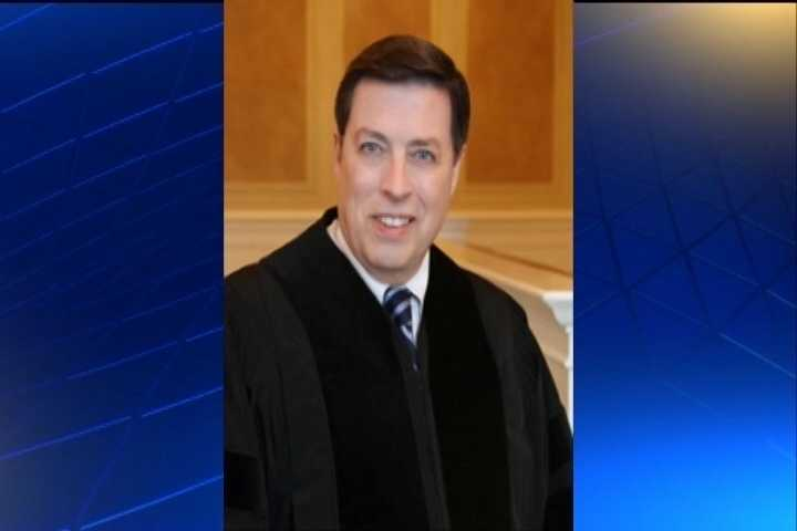 Chief Justice Jim Hannah graduated from the University of Arkansas School of Law. He's an attorney from Harrison.