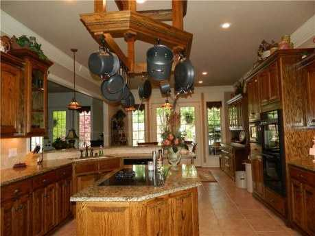The kitchen has wood cabinets, an isand, granite countertops and updated appliances!