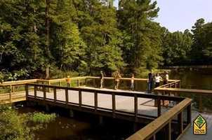 Logoly State Park in McNeilAt Arkansas's first environmental education state park, interpreters present workshops on ecological/environmental topics. The park's natural resources provide a living laboratory for students and visitors. Most of Logoly's 368 acres comprise a State Natural Area that includes unique plant species and mineral springs.