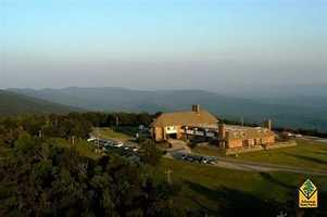 "Queen Wilhelmina State Park in MenaQueen Wilhelmina State Park's crowning attraction is its renowned hostelry, a historic lodging tradition born in 1898 with the original ""Castle in the Sky"" that has towered above the Ouachita Mountains for more than 100 years. This royal retreat sits atop 2,681-foot Rich Mountain, Arkansas's second highest peak."