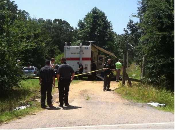 Investigators at crime scene in Rudy