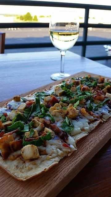 BBQ Chicken Flat Bread Pizza includes spinach, bacon, chicken, cheddar and mozzarella cheese and of course BBQ sauce. Will run you $12. Flaps Down Grill also offers a Kids Menu!