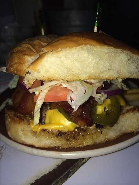 The Mark Burger includes a .40 lb ground chuck patty with bacon, jalapenos, American cheese, mustard, and miracle whip