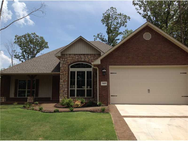 9009 S 12th St., Fort Smith, ARWalk into elegance with 14' vaulted ceilings, wood floors and open living area setting. This is a split bedroom home offering 3 BR &2 BA with the master bath having a tiled walk in shower, whirlpool tub and a large walk in closet. This amazing floor plan, gives it the perfect flow. Granite, stained stamped walk-ways coupled with rubbed oil bronze plumbing /light fixtures & cent vac are just a few of the things that makes it feel perfect.