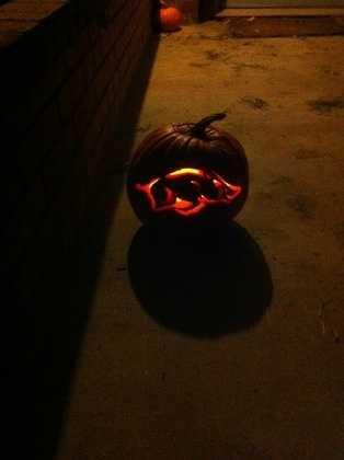 By JoshRoss:Razorback pumpkin I (Josh Ross) carved.Graysen Ross as Alice in Wonderland (in front of the hog pumpkin).