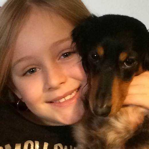 My granddaughter Madison and my dachshund Gretel in Siloam Springs