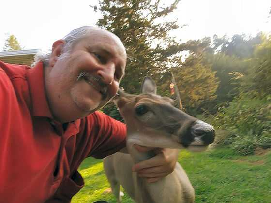 Memo the doe I raised is a little over 4 years old and so far has brought 2 deer into this world so far. As I hug her neck and we pose for ya'll and I hopes ya'll enjoys this.