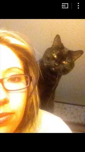 This is my cat Boo&#x3B; she loves to jump onto my back.