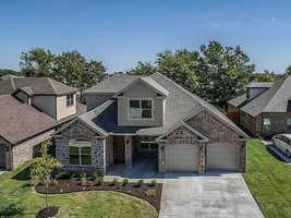 807 SW Caprington St., Bentonville, AR - Your chance to live in a geothermal home! This community is striving to live green without sacrificing the amenities you expect. Amenities include: hardwood flooring, 3 cm granite counters, artistically tiled showers, ss appliances w/ gas cook top & vented hood, surround sound, plumbed for central vac, crown molding. Save money off your utility bill by going green w/ geothermal!