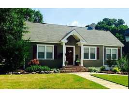 Straight out of the Pottery Barn! This house is a show stopper! Featuring 4 bedrooms, 2 baths, formal living w/fireplace, formal dining, nice kitchen w/gas range, huge game or media room, office w/knotty pine paneling, original hardwood floors, charming, built-ins, fenced backyard w/a beautiful established garden, one car garage, and so much more. Tons of updates call for details! SECURITY SYSTEM IS LEASED.