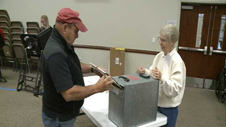 Voting at the Mt. Comfort Church of Christ in Fayetteville Tuesday morning.